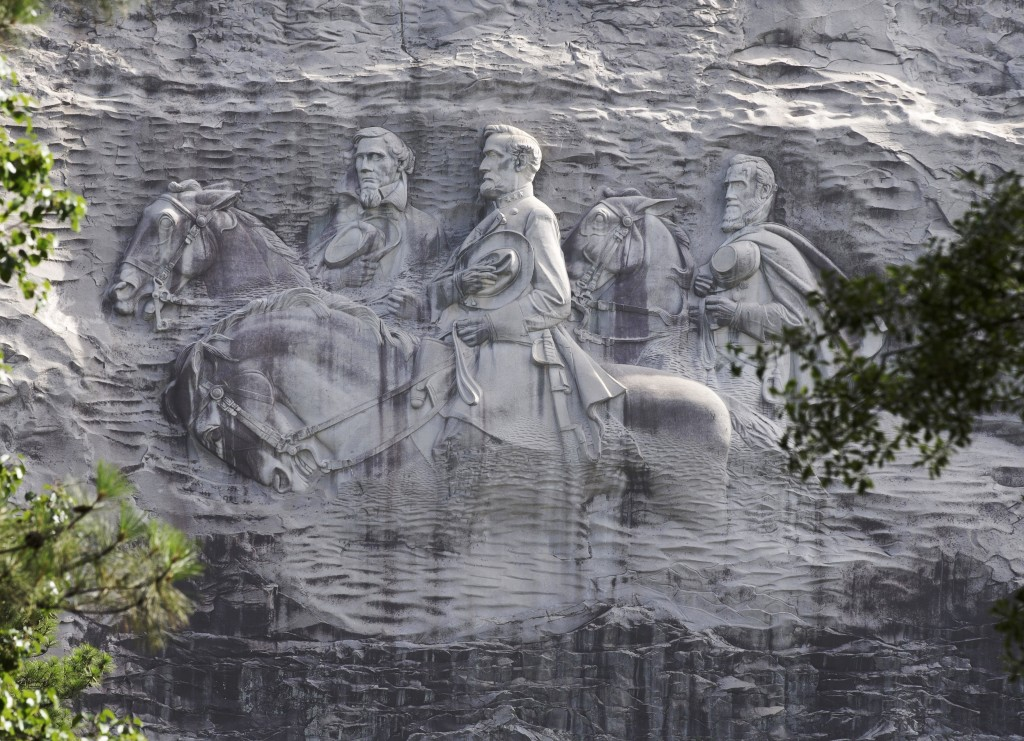 FILE - This June 23, 2015 file photo shows a carving depicting Confederate Civil War figures Stonewall Jackson, Robert E. Lee and Jefferson Davis, in ...