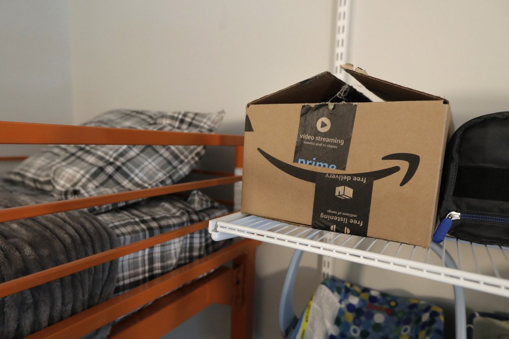An Amazon delivery box sits on a shelf of the room of Connie Wade, Wednesday, June 17, 2020, at Mary's Place, a family homeless shelter located inside...