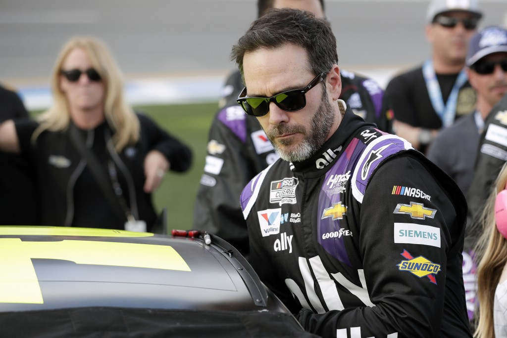 FILE - In this Feb. 16, 2020 file photo Jimmie Johnson climbs intp his car before the NASCAR Daytona 500 auto race at Daytona International Speedway i...