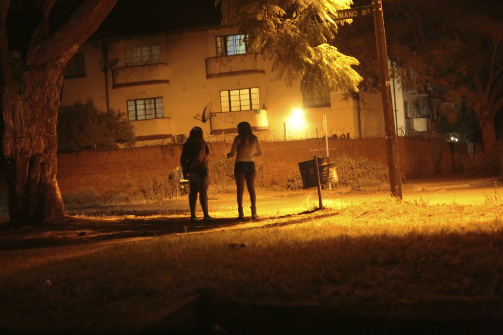 Sex workers wait for clients in the red light district of Harare, Zimbabwe, Friday, June 12, 2020. As the coronavirus spreads in Africa, it increasing...