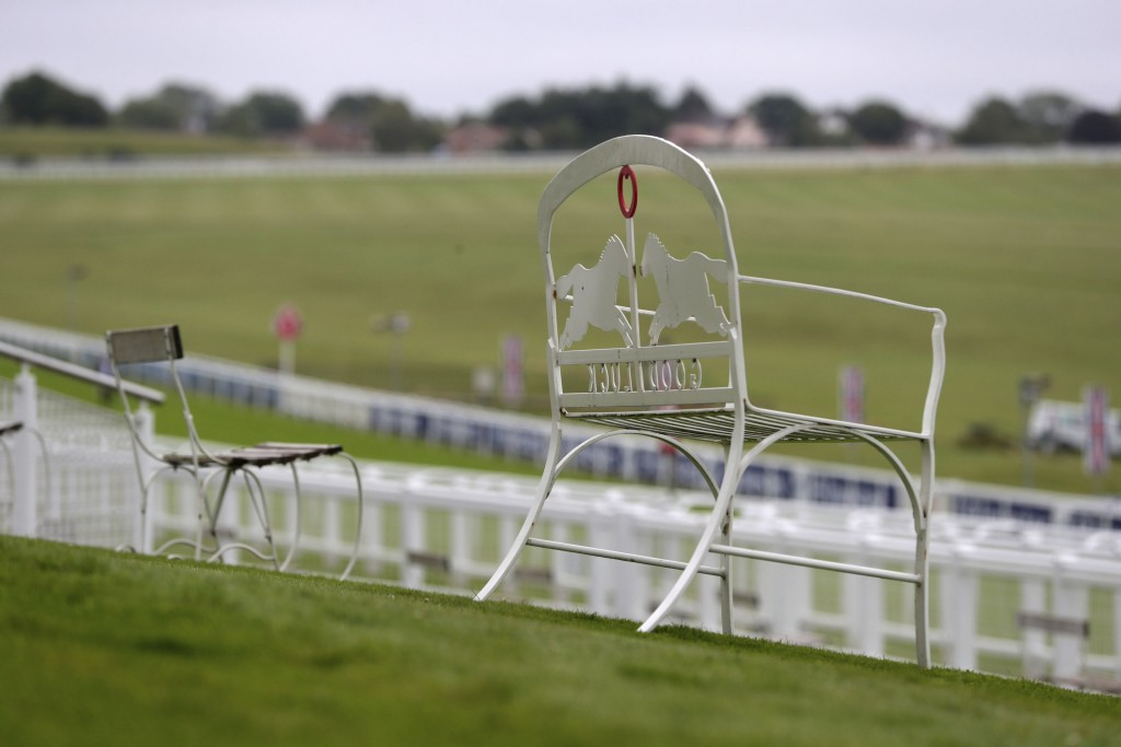 A view of empty seating at Epsom Racecourse, in Epsom, England, Saturday July 4, 2020. The Derby annual horse race will take place at the Epsom Downs ...