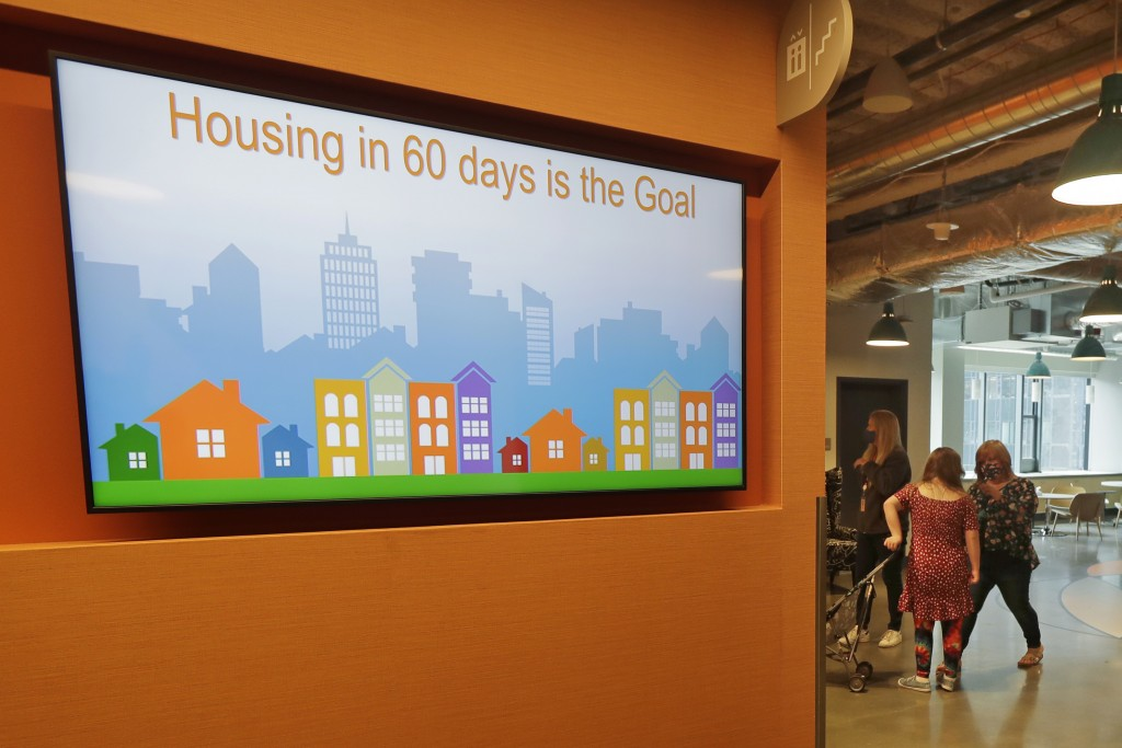 A video display shows one of the goals of Mary's Place, a family homeless shelter located inside an Amazon corporate building on the tech giant's Seat...