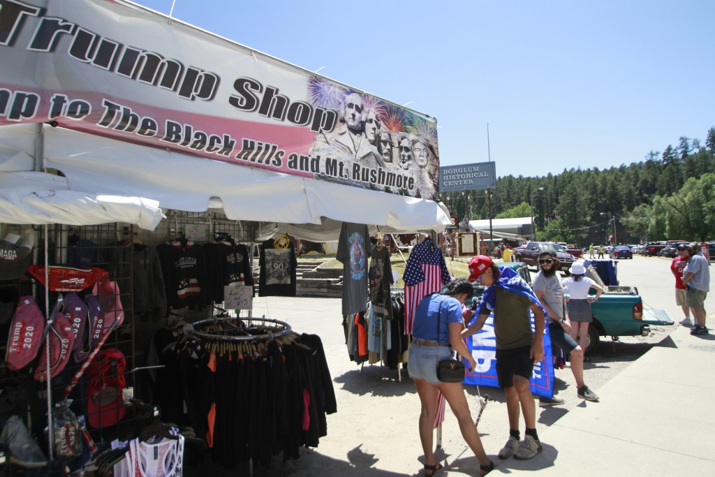 People shop for Trump memorabilia in Keystone, S.D. on Friday, July 3, 2020 ahead of a fireworks display at Mount Rushmore the president is expected t...