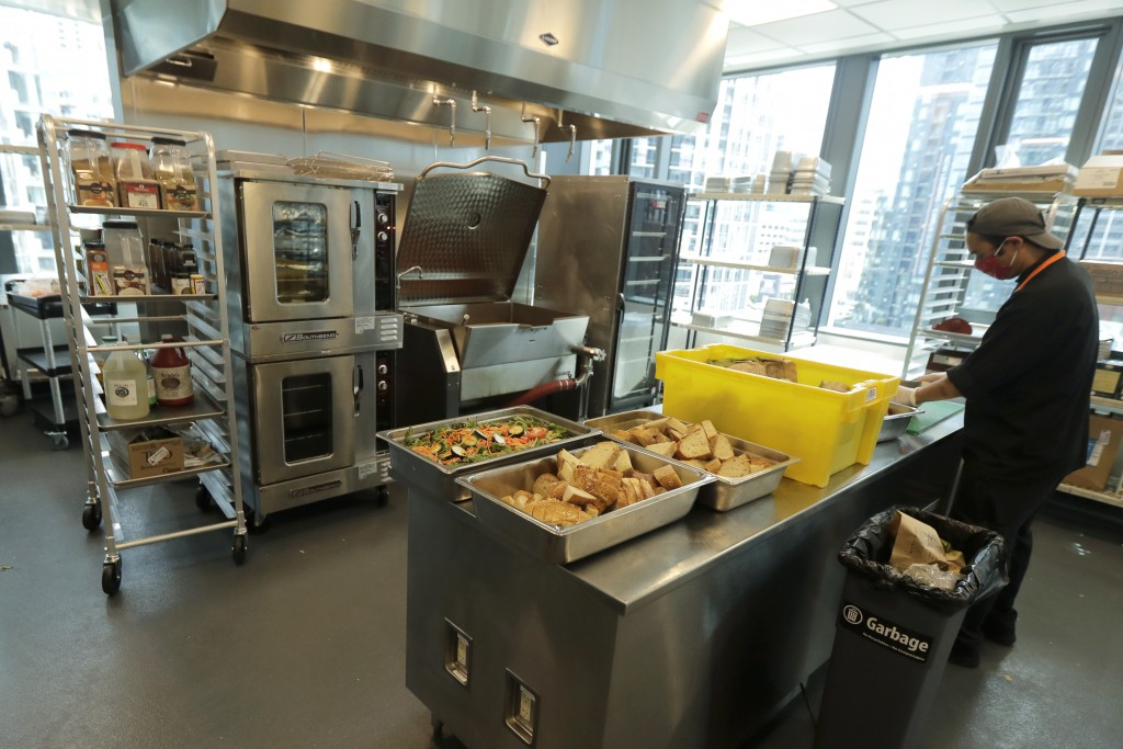 Joseph Robello, lead cook at Mary's Place, a family homeless shelter located inside an Amazon corporate building on the tech giant's Seattle campus, p...