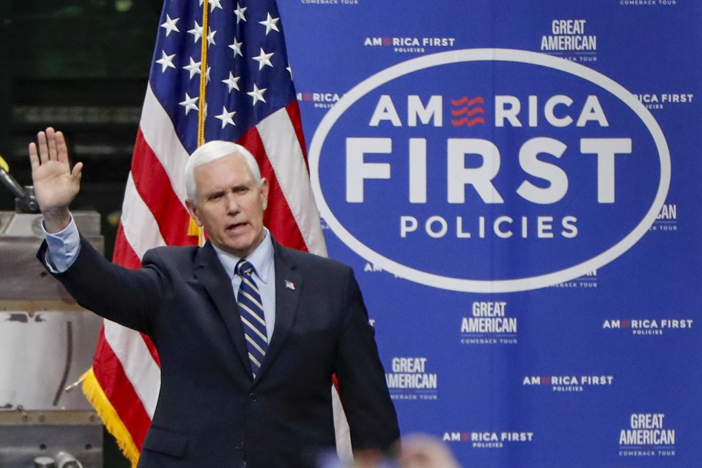 FILE - In this June 12, 2020, file photo Vice President Mike Pence, waves as he arrives to speak after a tour at Oberg Industries plant in Sarver, Pa....