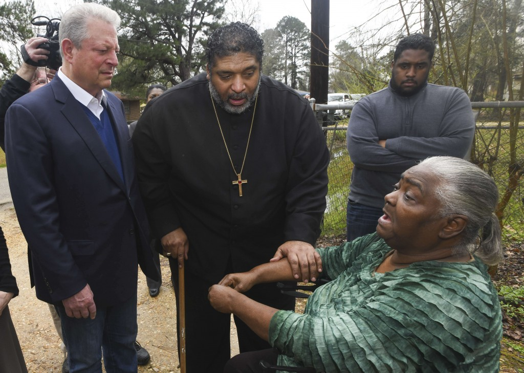 FILE - In this Feb. 21, 2019, file photo, former Vice President Al Gore, left, founder of the Climate Reality Project, and the Rev. William Barber II,...