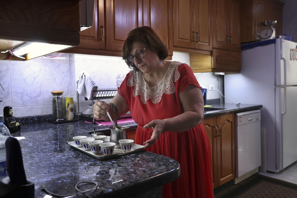Laure Ghosn, whose husband Charbel Zogheib has been missing for the past 37 years, makes coffee at her home in Sarba, north of Beirut, Lebanon on June...
