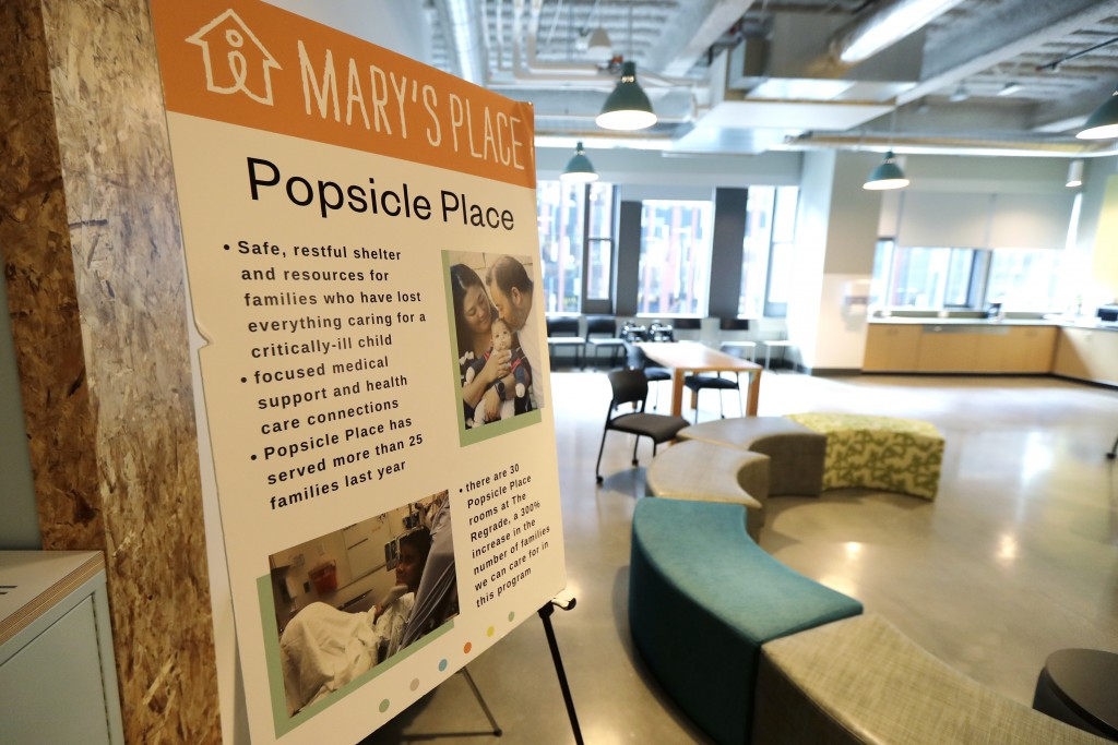 A sign outlines services offered by the Popsicle Place shelter program at Mary's Place, a family homeless shelter located inside an Amazon corporate b...