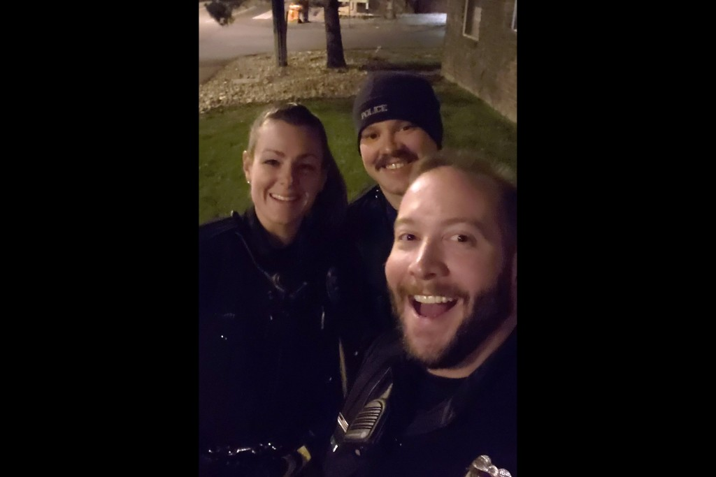 This photo released by the Aurora Police Department, in Colorado, shows Officers Erica Marrero, from left, Jaron Jones and Kyle Dittrich. Jason Rosenb...