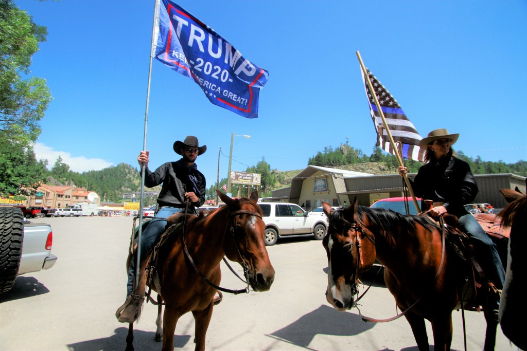 A group with Cowboys For Trump shows their support for the president in Keystone, S.D. on Friday, July 3, 2020. (AP Photo/Stephen Groves)