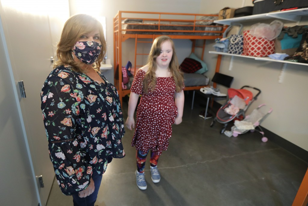 Connie Wade, left, poses for a photo with her daughter Emilyanne, 12, Wednesday, June 17, 2020, in their room at Mary's Place, a family homeless shelt...