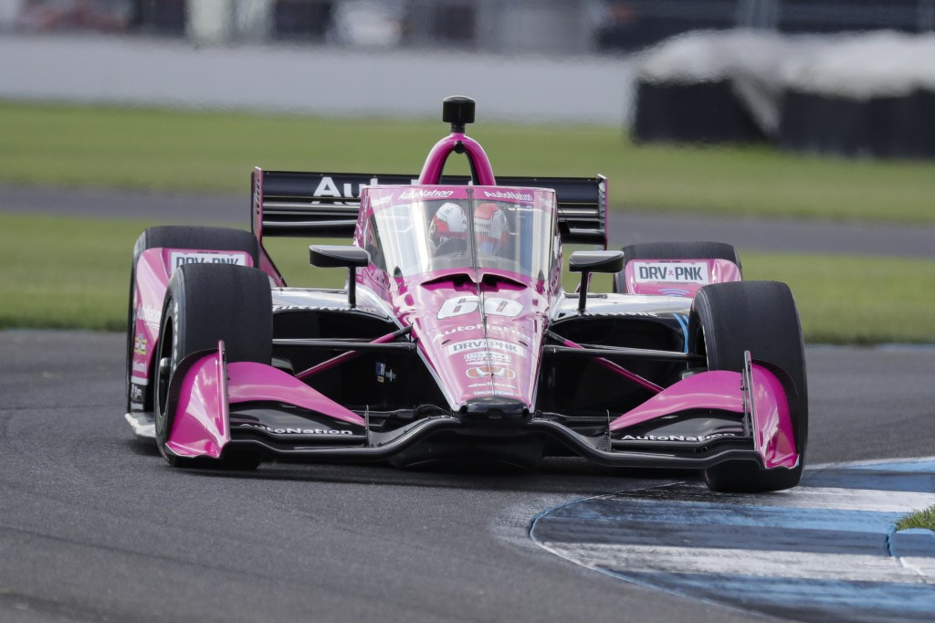 Race driver Jack Harvey, of Great Britain, drives through a turn during qualifying for the IndyCar auto race at Indianapolis Motor Speedway in Indiana...