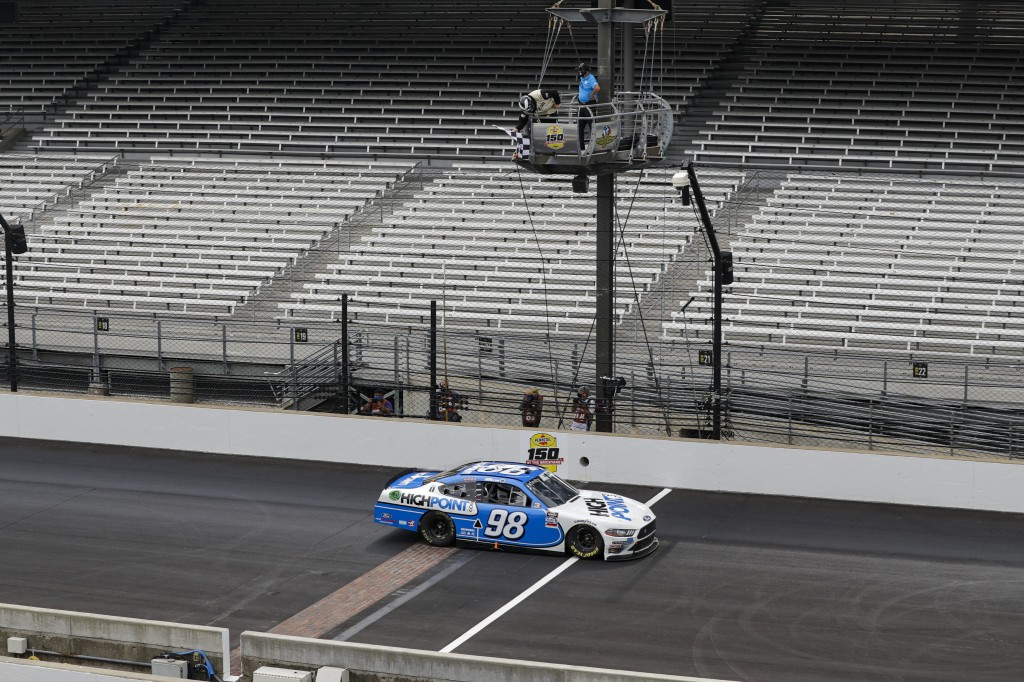 NASCAR Xfinity Series driver Chase Briscoe takes the checked flag to win the NASCAR Xfinity Series auto race at Indianapolis Motor Speedway in Indiana...