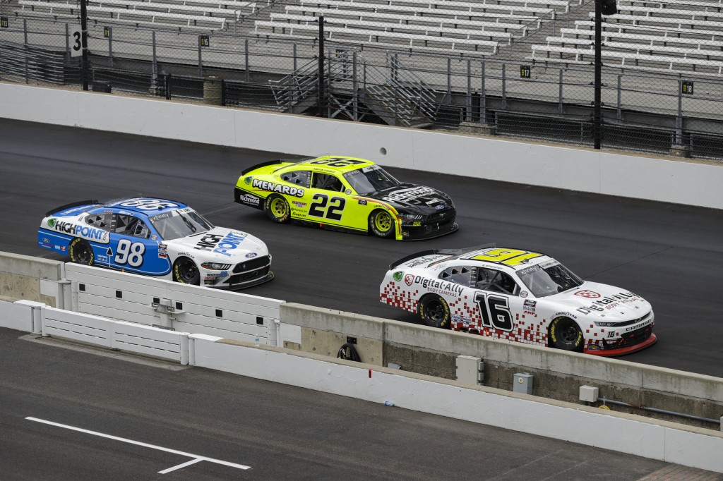 NASCAR Xfinity Series drivers AJ Allmendinger (16), Austin Cindric (22) and Chase Briscoe (98) battle for the lead in the closing laps the NASCAR Xfin...