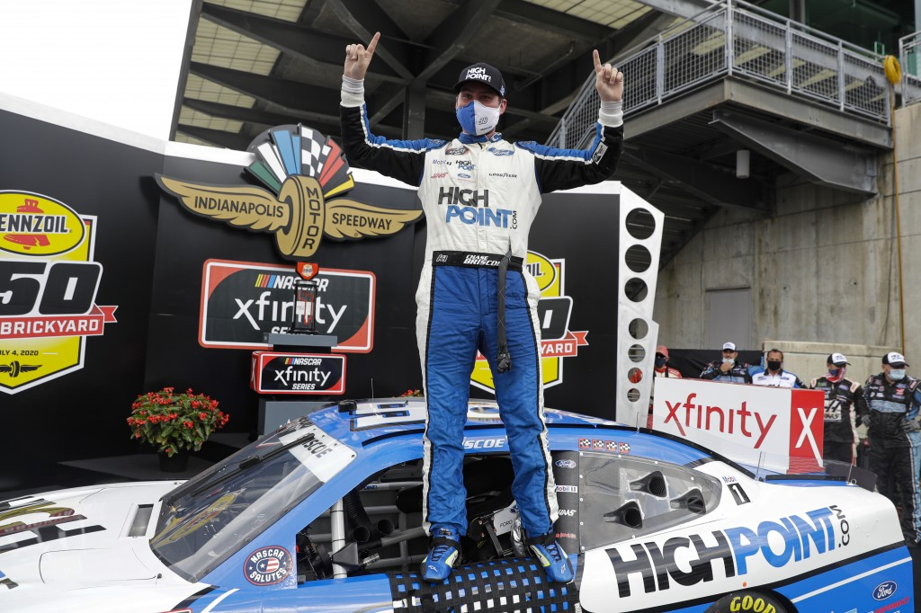 NASCAR Xfinity Series driver Chase Briscoe celebrates winning the NASCAR Xfinity Series auto race at Indianapolis Motor Speedway in Indianapolis, Satu...