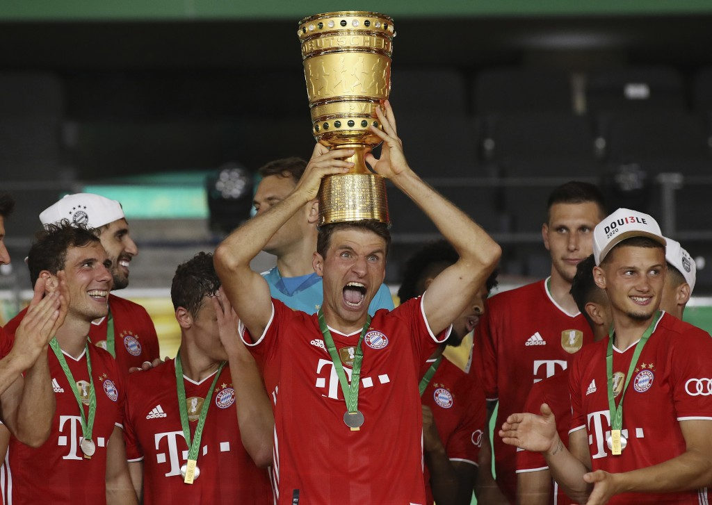 Munich's Thomas Mueller celebrates with the trophy after winning the DFB Cup final match between Bayer 04 Leverkusen and FC Bayern Muenchen at Olympia...