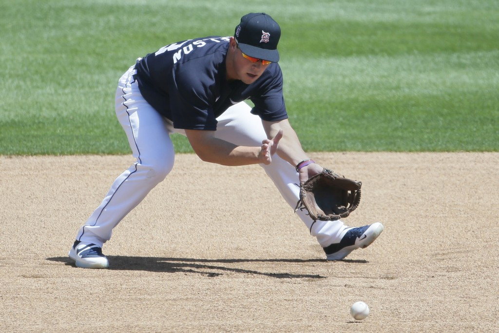 Detroit Tigers' Spencer Torkelson fields a ground ball during baseball training camp at Comerica Park, Saturday, July 4, 2020, in Detroit. (AP Photo/D...