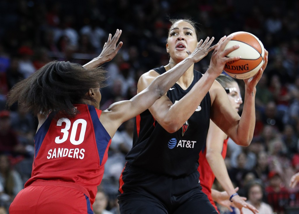 FILE - In this Tuesday, Sept. 24, 2019, file photo, Las Vegas Aces' Liz Cambage shoots against Washington Mystics' LaToya Sanders during the first hal...