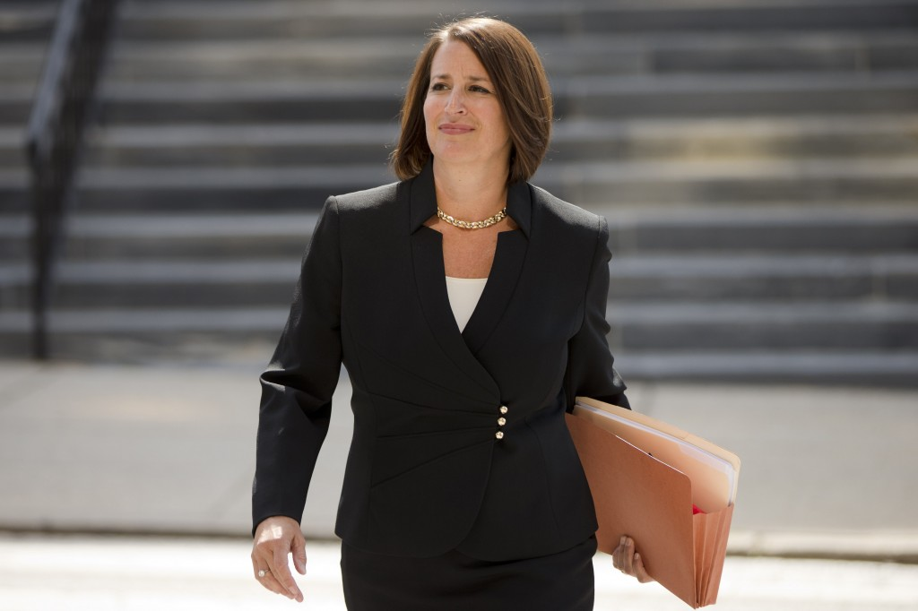 FILE - In this Thursday, Aug. 6, 2015, file photo, former Montgomery County District Attorney Risa Vetri Ferman walks to a news conference, in Norrist...