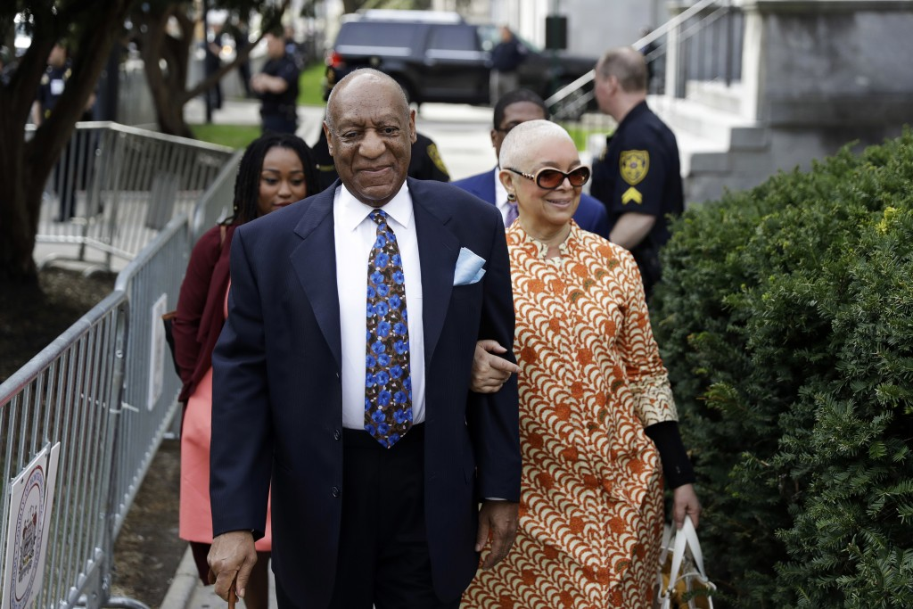 FILE - In this April 24, 2018, file photo, Bill Cosby, left, arrives with his wife, Camille Cosby, for his sexual assault trial at the Montgomery Coun...