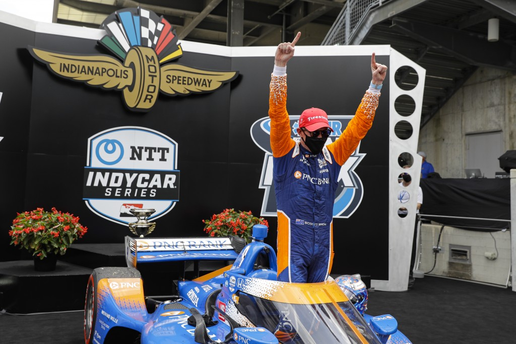 Race driver Scott Dixon, of New Zealand, celebrates after winning the IndyCar auto race at Indianapolis Motor Speedway in Indianapolis, Saturday, July...