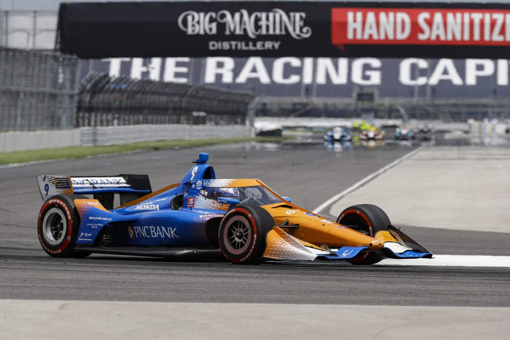 Race driver Scott Dixon, of New Zealand, drives through a turn during the IndyCar auto race at Indianapolis Motor Speedway in Indianapolis, Saturday, ...