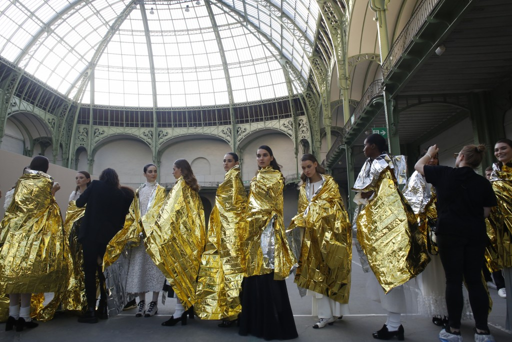 FILE - In this Jan. 21, 2020 file photo, models wait before the presentation of Chanel Haute Couture Spring/Summer 2020 fashion collection, in Paris. ...