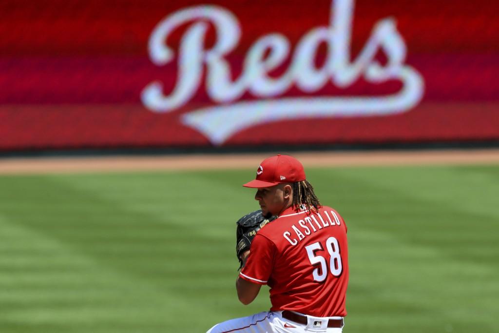 Cincinnati Reds' Luis Castillo (58) throws during team baseball practice at Great American Ballpark in Cincinnati, Sunday, July 5, 2020. (AP Photo/Aar...