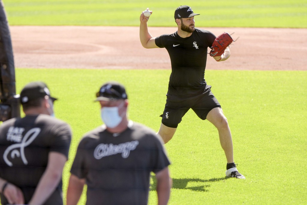 Chicago White Sox pitcher Lucas Giolito sets up to throw the ball to first base during practice at Guaranteed Rate Field on Sunday, July 5, 2020, in C...