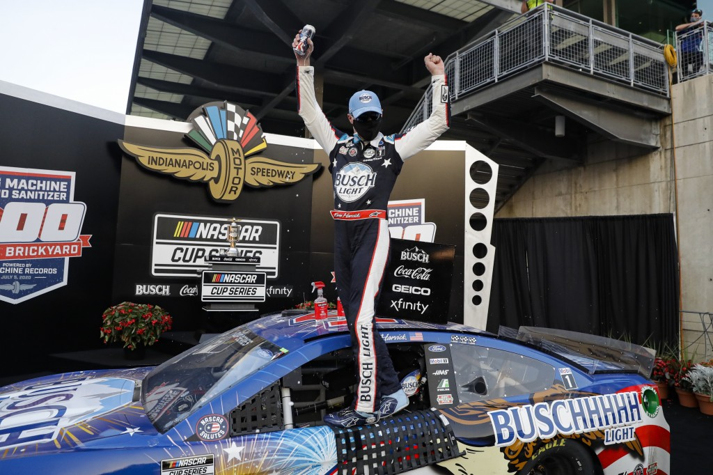 Race driver Kevin Harvick celebrates after winning the NASCAR Cup Series auto race at Indianapolis Motor Speedway in Indianapolis, Sunday, July 5, 202...
