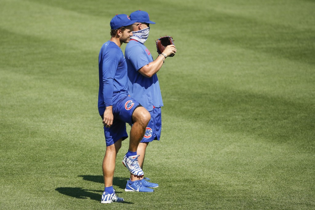 Chicago Cubs first baseman Anthony Rizzo, left, stands next to manager David Ross, right, during baseball practice at Wrigley Field, Sunday, July 5, 2...