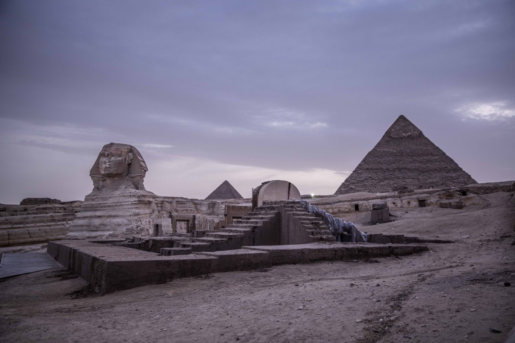 FILE - This March 30, 2020 file photo, shows the empty Giza Pyramids and Sphinx complex on lockdown due to the coronavirus outbreak in Egypt. In July,...