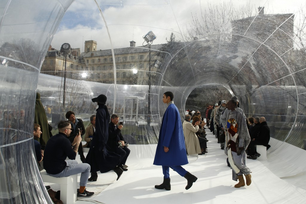 FILE - In this Feb. 26, 2020 file photo, models wear creations for the Kenzo fashion collection during Women's fashion week Fall/Winter 2020/21 presen...