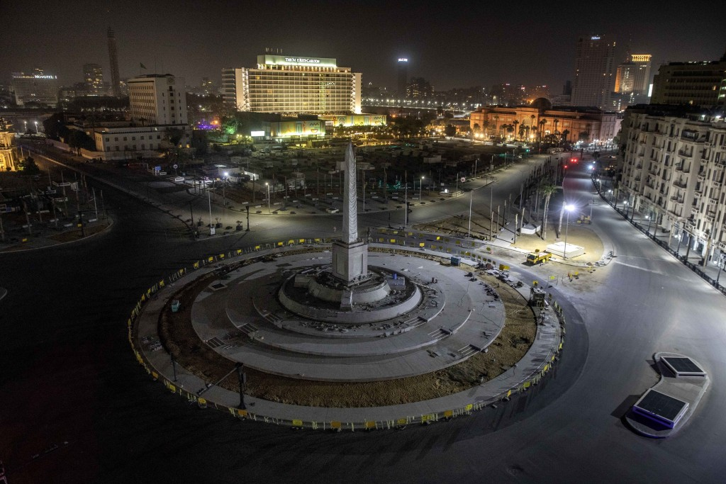 FILE - In this March 29, 2020 file photo, Tahrir Square, which was the focal point of the Jan. 25, 2011 Egyptian uprising that toppled autocrat Hosni ...