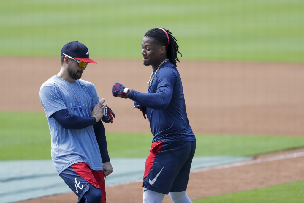 Atlanta Braves' Ronald Acuña Jr., right, and Ender Inciarte, left, horseplay during team practice at Truist Park on Sunday, July 5, 2020, in Atlanta. ...