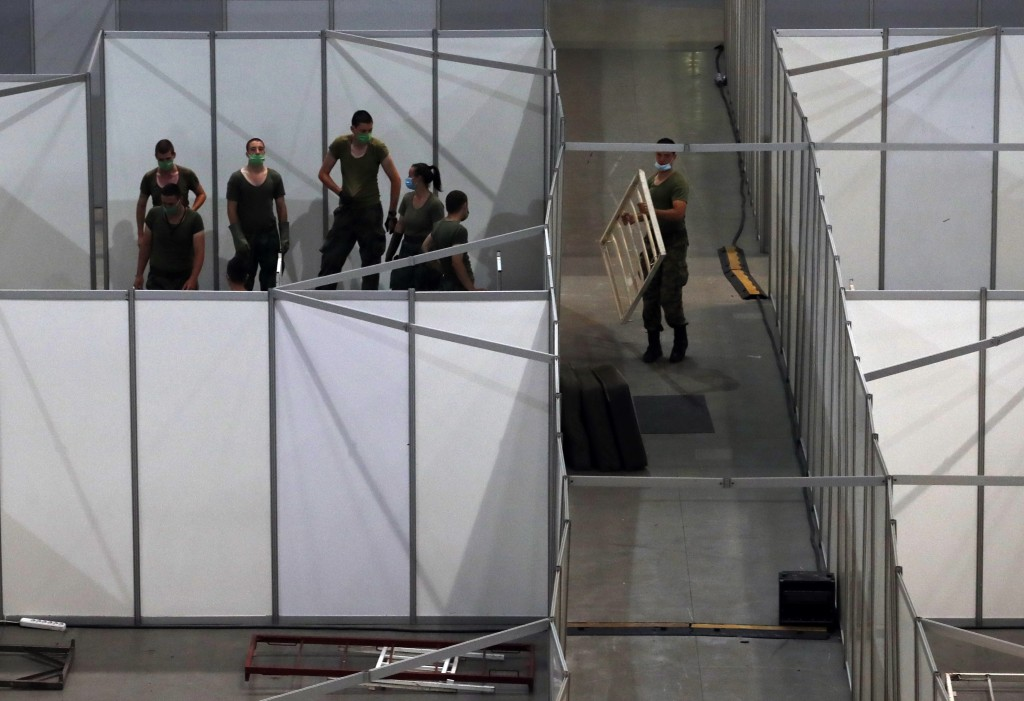 Serbian soldiers set up beds for the treatment of possible COVID-19 infected patients inside of the Belgrade Arena, in Belgrade, Serbia, Monday, July ...