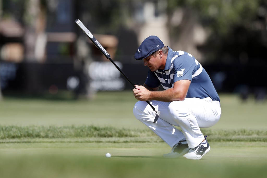 Bryson DeChambeau studies his putt on the 13th green during the final round of the Rocket Mortgage Classic golf tournament, Sunday, July 5, 2020, at D...