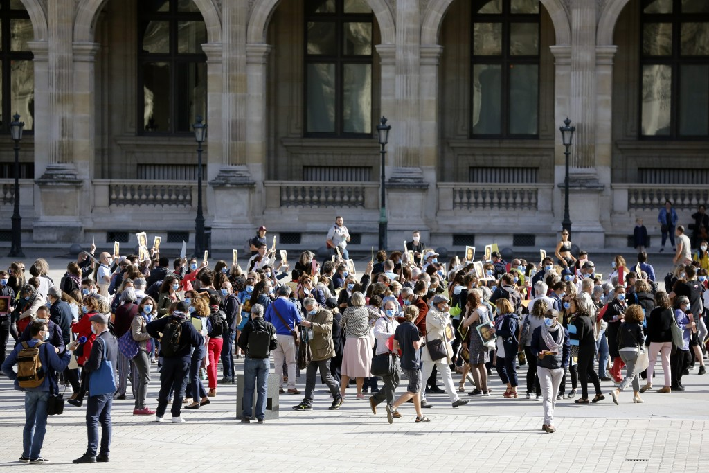 Guide speakers demonstrate to warn about their financial situation in front of the Louvre Museum, in Paris, Monday, July 6, 2020. The home of the worl...