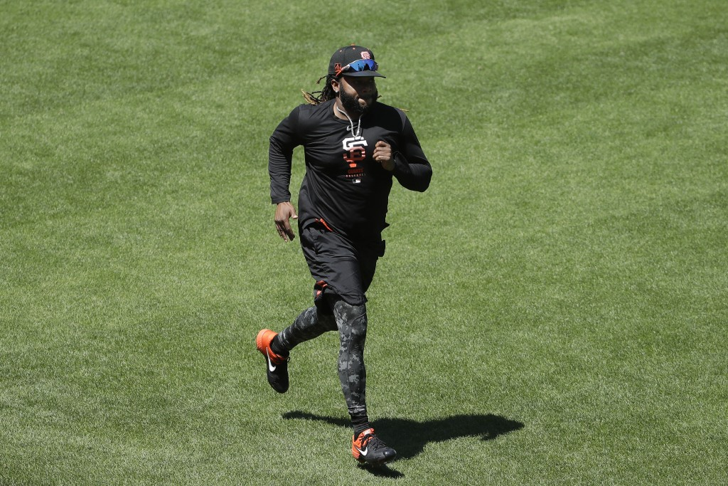 San Francisco Giants pitcher Johnny Cueto runs during a baseball practice in San Francisco, Sunday, July 5, 2020. (AP Photo/Jeff Chiu)