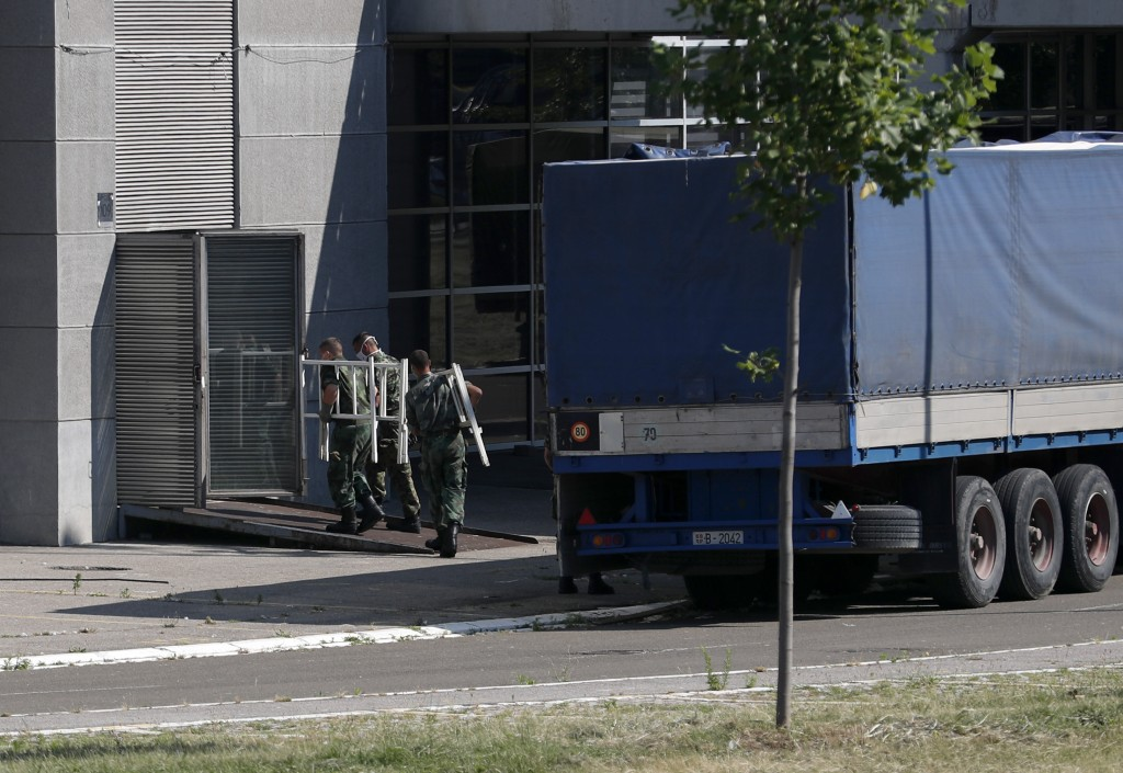Serbian soldiers set up beds for treatment of possible COVID-19 infected patients inside of the Belgrade Arena, in Belgrade, Serbia, Monday, July 6, 2...