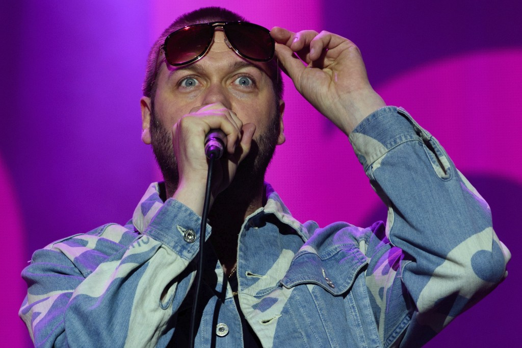 FILE - In this Saturday, Aug. 22, 2015 file photo, Tom Meighan from British band, Kasabian performs on stage during V Festival 2015 at Hylands Park in...
