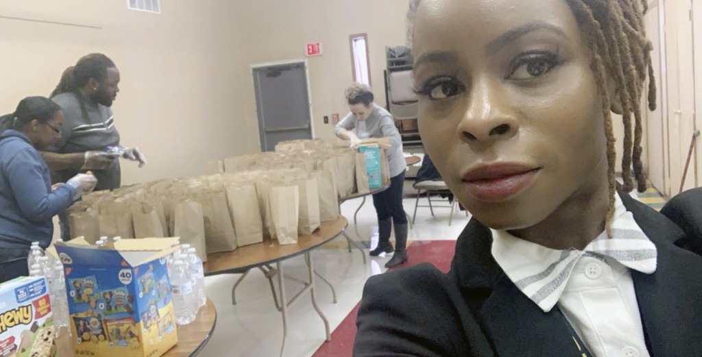 This undated photo provided by Hattie Norwood in July 2020 shows her during efforts by the group Proactive Community Involvement to deliver free meals...
