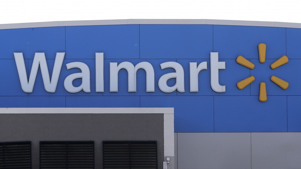 FILE - In this Sept. 3, 2019 file photo, a Walmart logo is displayed outside of a Walmart store, in Walpole, Mass. Across the country, drug and alcoho...