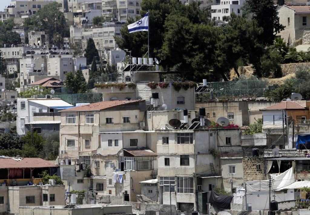 An Israeli flag flies over a Jewish owned house in a Palestinian neighborhood of Silwan in east Jerusalem, Wednesday, July 1, 2020. Israeli leaders pa...