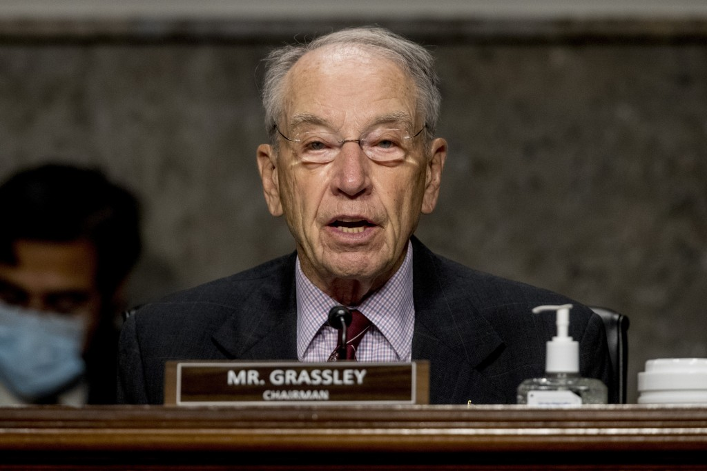 FILE - In this June 17, 2020, file photo, Chairman Sen. Chuck Grassley, R-Iowa, speaks as U.S. Trade Representative Robert Lighthizer appears at a Sen...