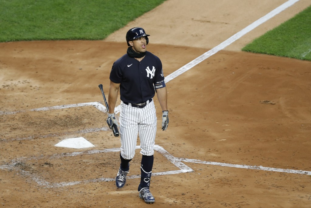 New York Yankees designated hitter Giancarlo Stanton walks back to the dugout after striking out during an intrasquad baseball game Monday, July 6, 20...