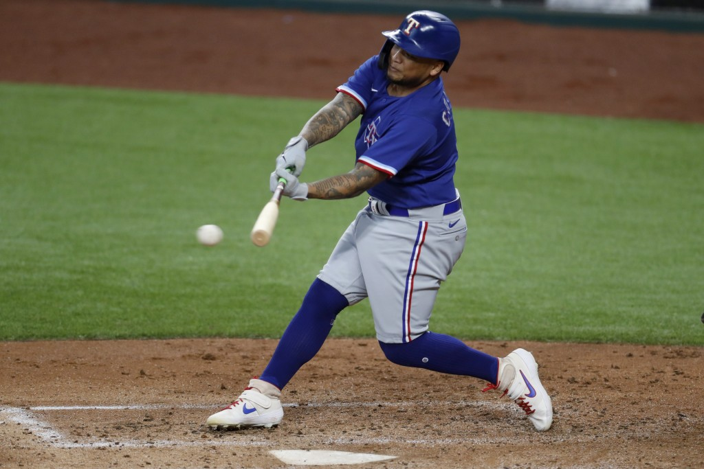 Texas Rangers' Willie Calhoun connects for a hit during an intrasquad practice baseball game at Globe Life Field in Arlington, Texas, Monday, July 6, ...