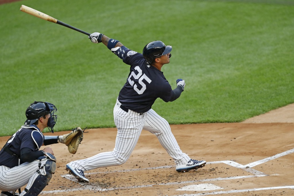 New York Yankees' Gleyber Torres follows through on his swing during an intrasquad baseball game Monday, July 6, 2020, at Yankee Stadium in New York. ...