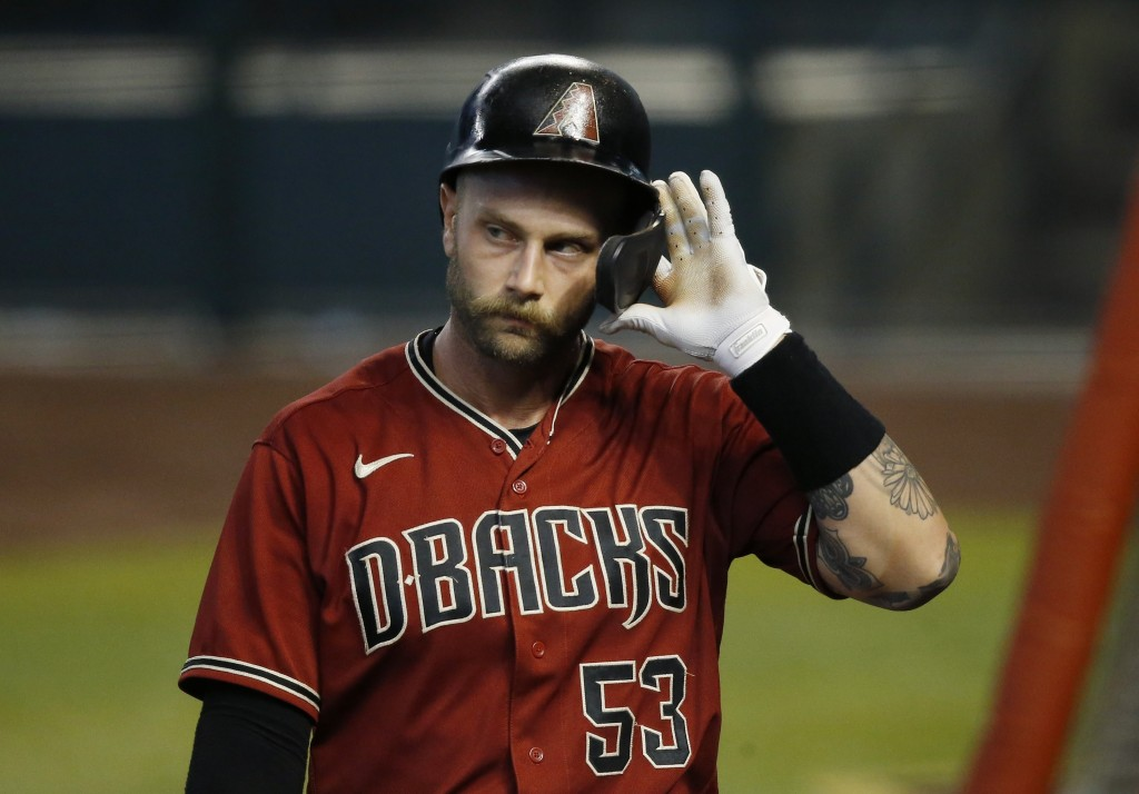 Arizona Diamondbacks' Christian Walker walks back to the dugout after striking out during an intrasquad baseball game at Chase Field, Monday, July 6, ...