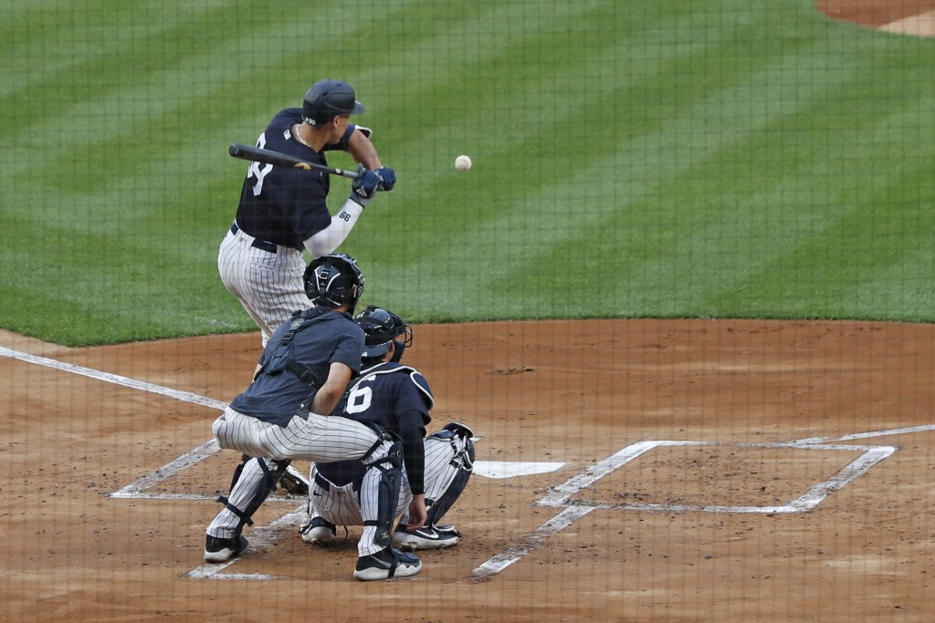 New York Yankees' Aaron Judge takes a pitch during an intrasquad baseball game Monday, July 6, 2020, at Yankee Stadium in New York. (AP Photo/Kathy Wi...